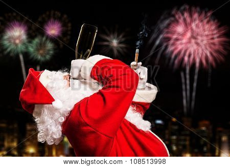 Santa Claus relaxing with champagne and a cigar during new year's eve
