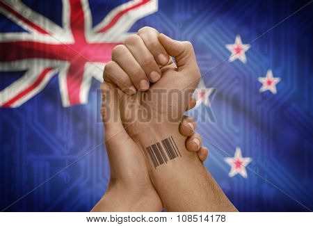 Barcode Id Number On Wrist Of Dark Skinned Person And National Flag On Background - New Zealand