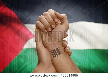 Barcode Id Number On Wrist Of Dark Skinned Person And National Flag On Background - Palestine