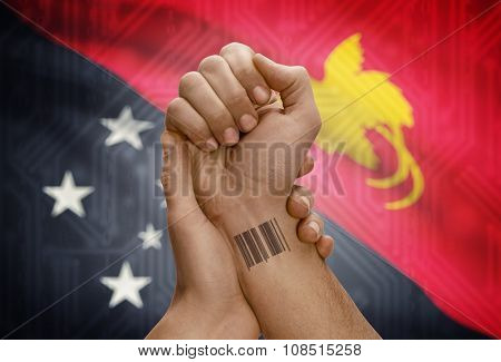 Barcode Id Number On Wrist Of Dark Skinned Person And National Flag On Background - Papua New Guinea