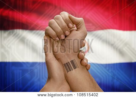 Barcode Id Number On Wrist Of Dark Skinned Person And National Flag On Background - Paraguay