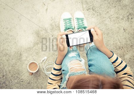Woman Holding Phone White Screen On Top View Vintage Style