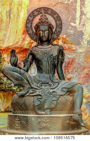 close-up black buddha statue in Thailand