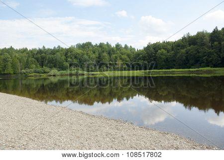 lake and trees gravel beach