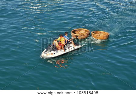 Nha Trang Vietnam - July 14 2015: A rescue canoe is towing two basket boat in the sea