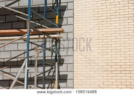 construction scaffolding on brick wall