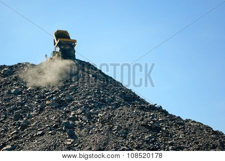 lorry delivering dumping rock