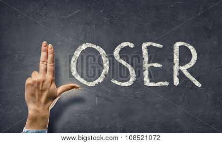 Loser word and human fingers instaed of letter L