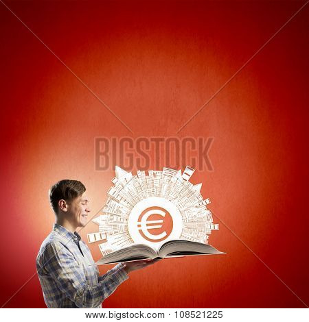 Young man in casual holding opened book with euro sign
