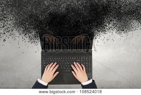 Top view of businesswoman hands using black laptop