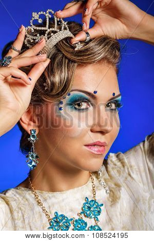 Girl With Face Art, Jewelry, Hair And Tiara.