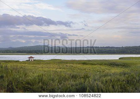 Lonely gazebo on the lake.