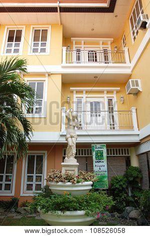 Cherubin Gardens facade and statue in Bulacan, Philippines