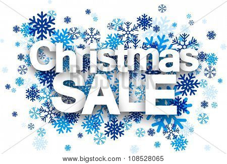 Christmas sale paper sign over blue snowflakes. Vector illustration.