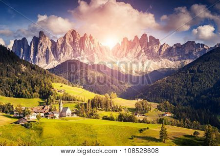 Countryside view of the Funes valley St. Magdalena or Santa Maddalena in the National park Puez Odle or Geisler. Dolomites, South Tyrol. Location Bolzano, Italy, Europe. Dramatic scene. Beauty world.