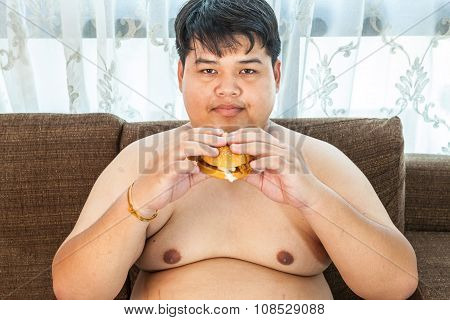 Fat Man Eating Hamburger Seated