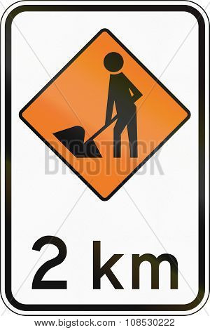 New Zealand Road Sign - Road Workers Ahead In 2 Kilometres