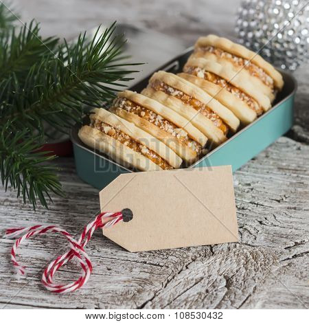 Cookies With Caramel Cream And Walnuts In A Vintage Metal Box, Christmas Decoration And A Clean, Emp
