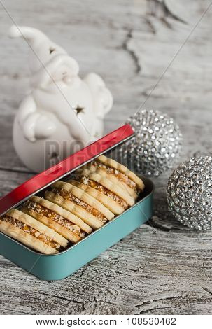 Homemade Cookies In Vintage Box, Ceramic Santa Claus And Christmas Decorations On A Light Wooden Sur