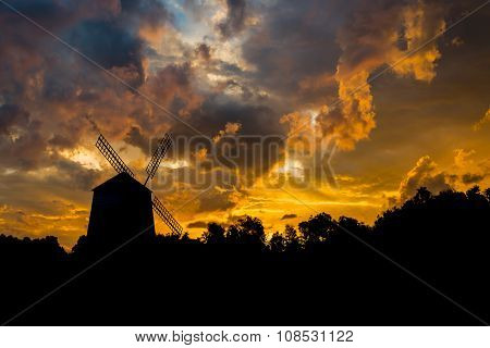 Silhouettes of widemill sunrise background