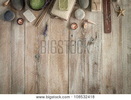 Composition of spa treatment on the wooden table with space for text. Top view