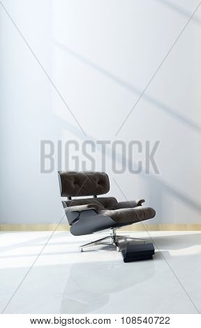 Modern black maximum comfort recliner chair with footstool in a shaft of sunlight in front of a white wall with copyspace in a home interior. 3d Rendering.