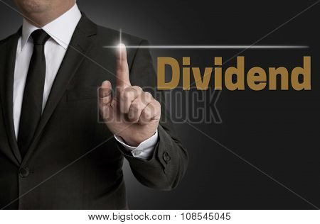 Dividend Touchscreen Is Operated By Businessman Concept