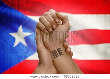 Barcode Id Number On Wrist Of Dark Skinned Person And National Flag On Background - Puerto Rico