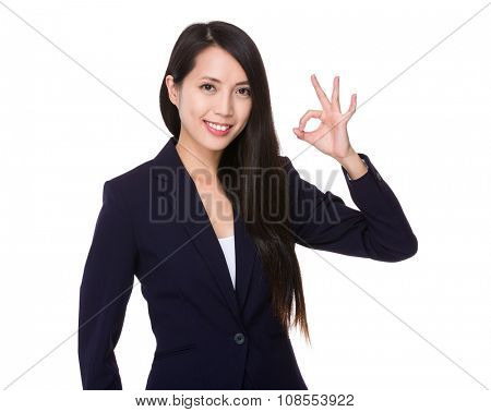 Asian Young Businesswoman showing ok sign gesture