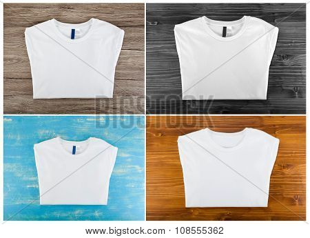 White Folded T-shirt Template On A Wooden Background