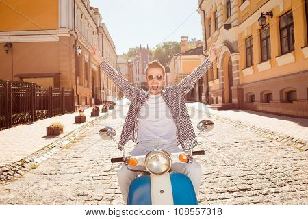 Handsome Happy Man Riding A Motorbike Picking Up Both Hands
