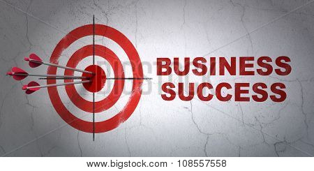 Business concept: target and Business Success on wall background