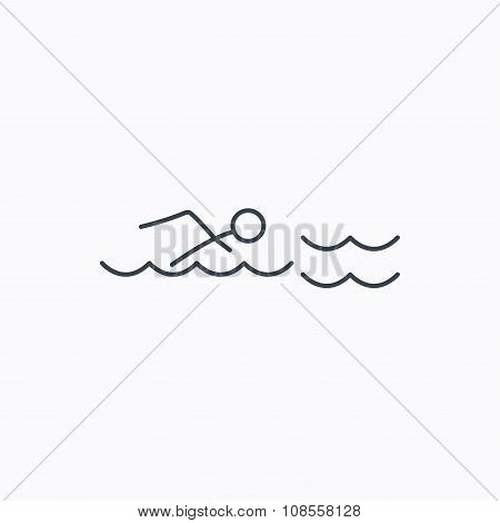 Swimming icon. Swimmer in waves sign.
