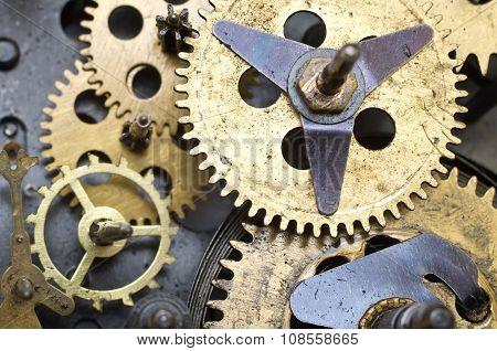 Gearwheels inside clock mechanism.