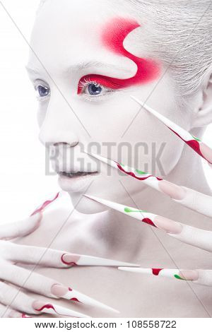 Art fashion girl with long color nails, white skin and red paint on the face. Creative art beauty.
