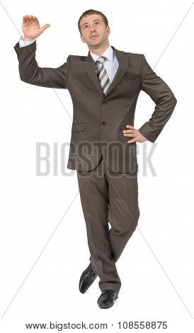 Businessman leans on empty space and looking up