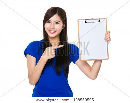 Asian Young Woman showing with the blank page of clipboard