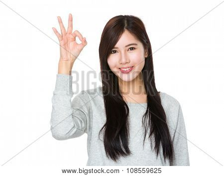 Young Woman showing ok sign gesture