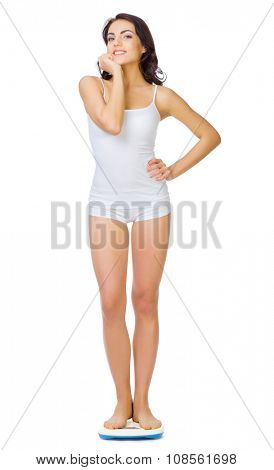 Healthy girl on scales isolated