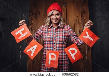 woman holding happy letters red flags, christmas theme