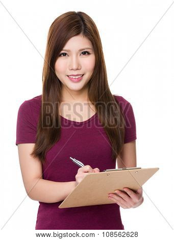 Woman take note on clipboard