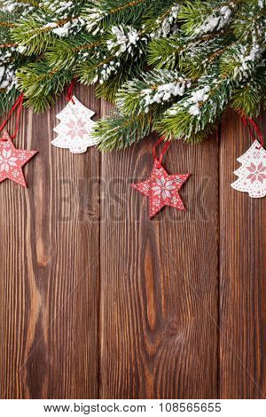 Christmas tree with decor on wooden table. View with copy space