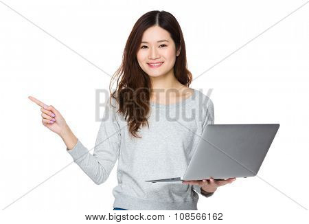 Young Woman hold with notebook computer and finger point up