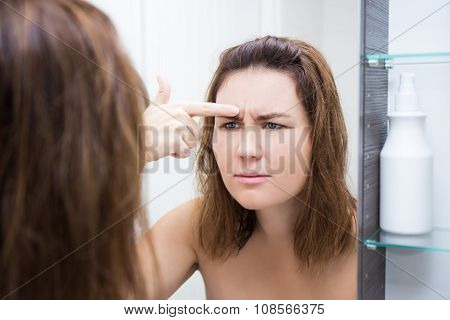 Problem Skin Concept - Beautiful Woman Looking At Mirror In Bathroom