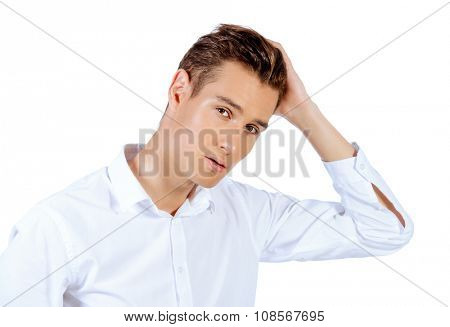 Close-up portrait of a handsome young man in white shirt. Men's beauty, fashion. Studio shot. Isolated over white background.