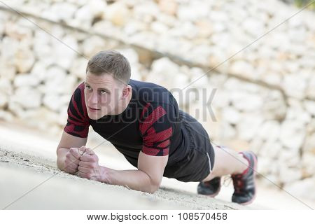 Man Runner Stretching .