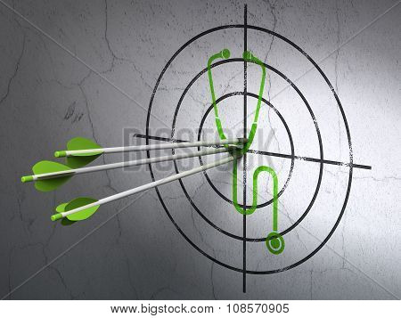 Medicine concept: arrows in Stethoscope target on wall background