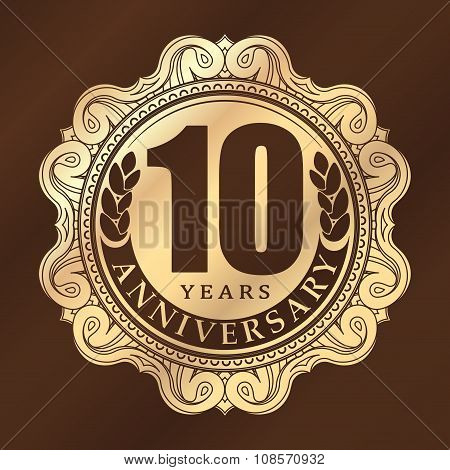 Vintage Anniversary 10 Years Round Emblem. Retro Styled Vector Background In Gold Tones On Dark Brow
