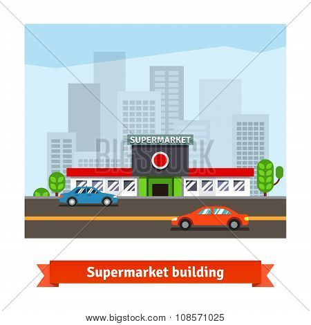 Roadside supermarket and cityscape background