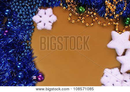 Golden background with Christmas balls and tinsel beaded
